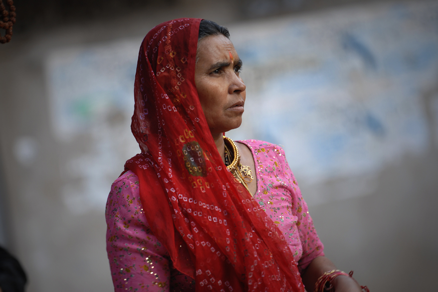 "<font color=""#f0d5a6"">Woman in Pushkar, India</font> <br />An Indian woman wearing a headscarf in Pushkar, India. Headscarves are scarves covering most or all of the top of a woman&rsquo;s hair and her head. Headscarves may be worn for a variety of purposes in India, such as for warmth, for sanitation, for fashion or social distinction. To see pics of the Pushkar Fair <a target=_blank href=http://www.esamskriti.com/photo-detail/Pushkar-Fair.aspx>Click here</a>"