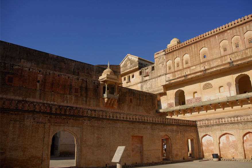 "<font color=""#f0d5a6"">Amber Fort, India</font> <br />A yard in the Amber Fort, India. Amber fort is located in Amer, 11 kilometres from Jaipur, Rajasthan state, India. It is one of the principal tourist attractions in the Jaipur area, located high on a hill. 