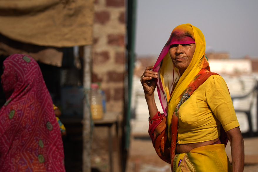 "<font color=""#f0d5a6"">Woman in Rajasthan, India</font> <br />An Indian woman near the road in the Rajasthani landscape. The northwestern part of Rajasthan is generally sandy and dry and most of this region is covered by the Thar Desert. The Indira Gandhi Canal is an exception in this dry region. 
