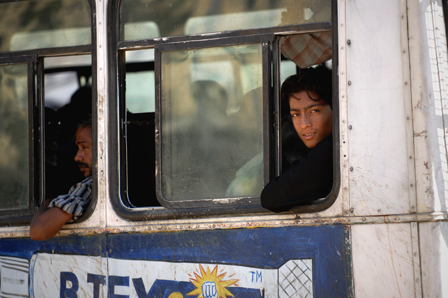"<font color=""#f0d5a6"">Young man in India</font> <br />A young Indian man is looking out of a bus window in Pushkar, India. Buses take up over 90% of public transport in Indian cities, and serve as a cheap and convenient mode of transport for all classes of society."