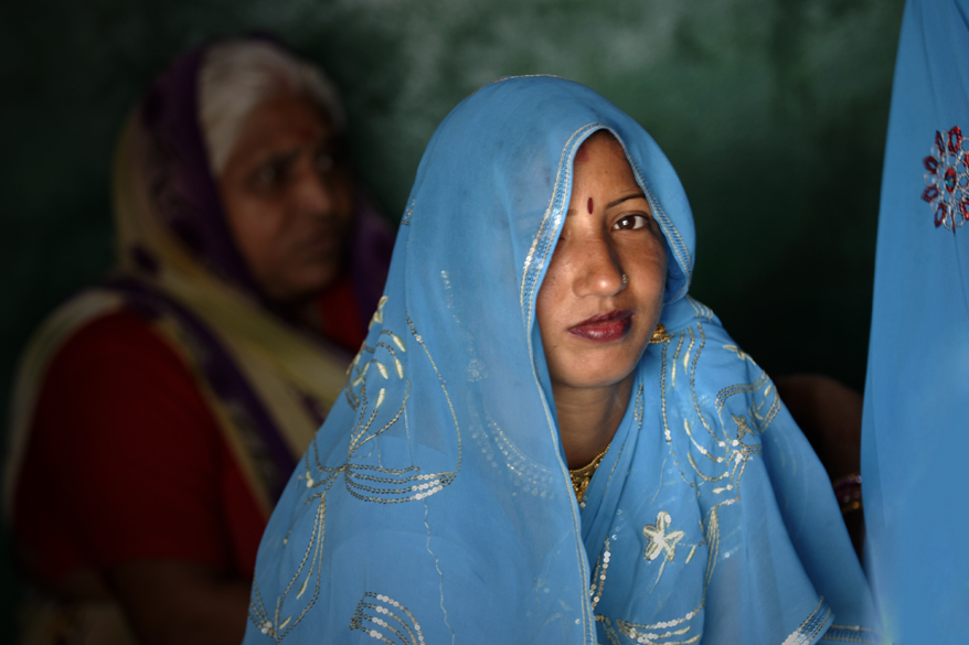 "<font color=""#f0d5a6"">Woman in blue, India</font> <br />An Indian woman wearing a sari in Pushkar, India. A sari is a long piece of fabric wound around the body and is worn by women all over India. <br />They are made in a variety of colours and patterns. Read about Origin of Saree 
