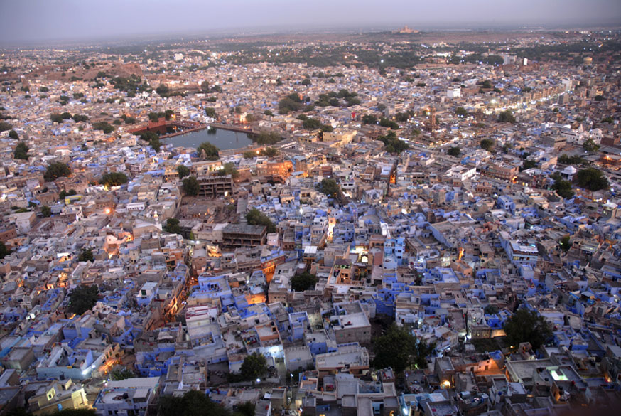 "<font color=""#f0d5a6"">Jodhpur, India</font> <br />Jodhpur seen from the Mehrangarh Fort. The city is known as the ""Sun City"" for the bright, sunny weather it enjoys all year. It is also referred to as the ""Blue City"" due to the vivid blue-painted houses around the Mehrangarh Fort. The old city circles the fort and is bounded by a wall with several gates.  <br />To see pics of the amazing Umaid Bhawan Palace in Jodhpur <a target=_blank href=http://www.esamskriti.com/photo-detail/Umaid-Bhawan-Palace.aspx>Click here</a>"