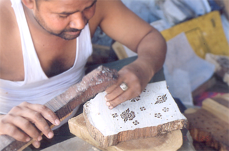 After the drawing is replicated on wood Sharmaji digs into the wood to bring out the actual design. Blocks are made on Sheesham wood. Sharmaji is a Jehangid Brahmin.