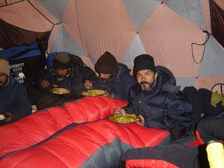 Having dinner while inside our sleeping bags. It was very cold.