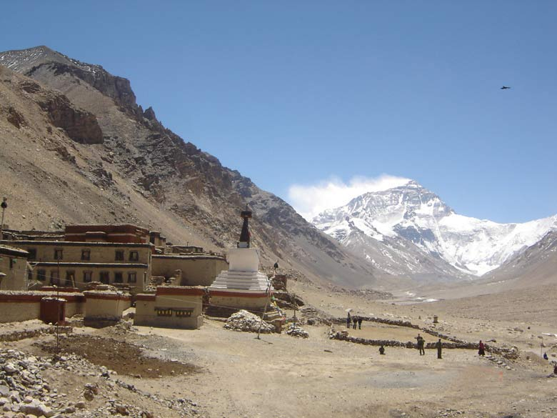 To your left is Rongbuk monastery ie the highest monastery in the world at 17,400 feet. The Everest base camp is located here.