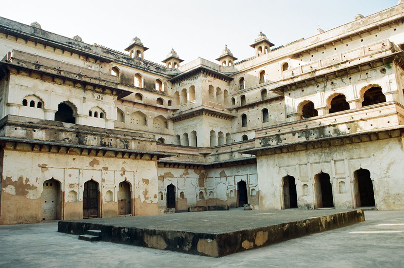 Raj Mahal, the second palace in the fort is well known for its murals depicting religious themes. Its plain exterior, a solid single block crowned by chhatris (umbrella like memorial cenotaphs). In the Janana (women's) chamber is a huge courtyard that overlooked the Queens rooms which is what you see.