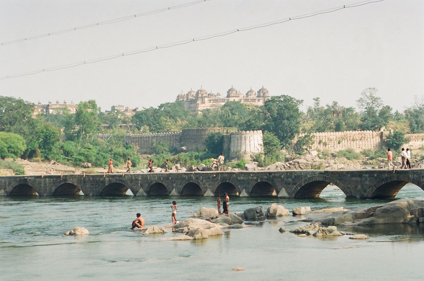In front see Betwa River, small bridge and background is fort wall of Raja Mahal complex. When we went river rafting we went below the bridge. Clicked this from the across the river i.e. wildlife sanctuary side.