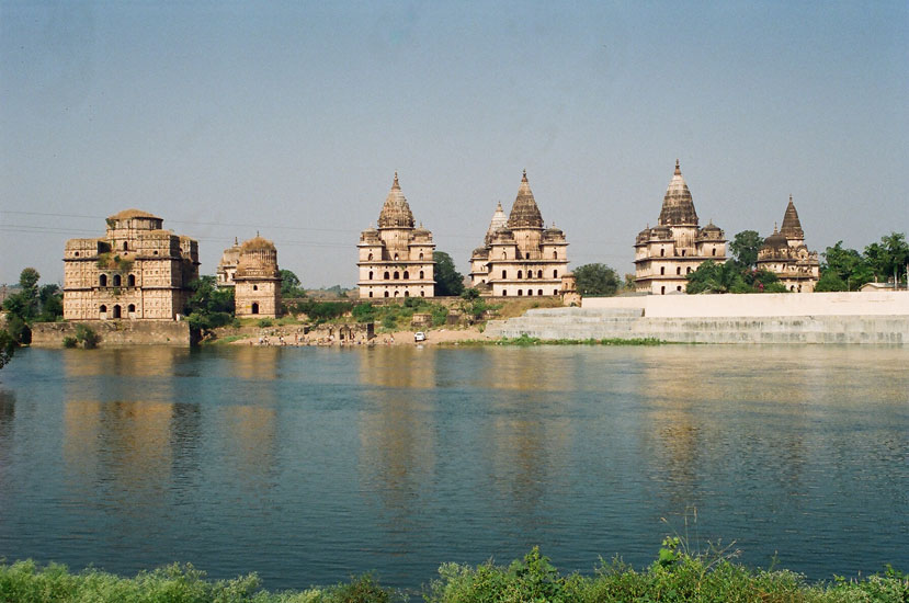 Orchha is app 20 kms from Jhansi. The Shatabdhi Express takes app 4 hours from Delhi to Jhansi. See Chhatris, Chaturbhuj Temple, Raja Mahal, Ram Mandir and Laxmi Narayan temple & Bundela paintings. You see the Chhatris on the banks of the river Betwa. River rafting starts from here.