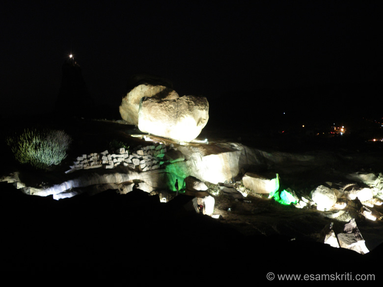 Boulders on Hemakuta Hill lit up.