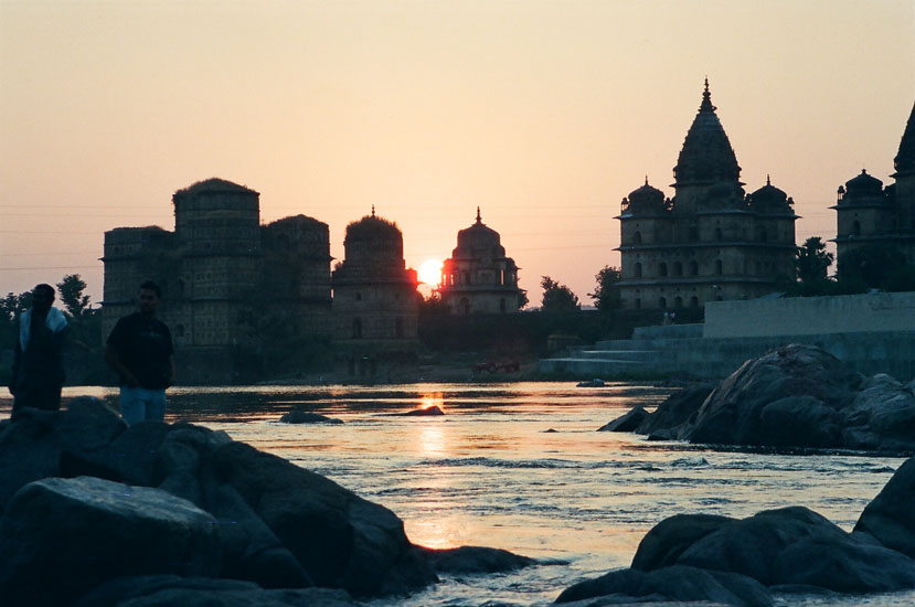 A sun set view with the chhatris. We spent one hour on the river banks with our feet in water. A city person like me loved it. There is a small bridge across the river.
