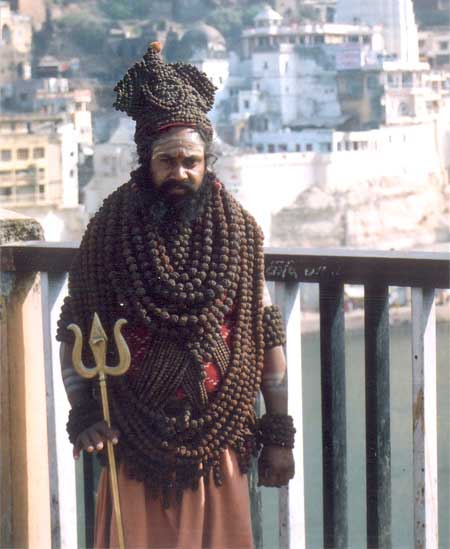 On the old bridge we met this bhakt who had dorned Rudraksh on the upper part of his body and head.