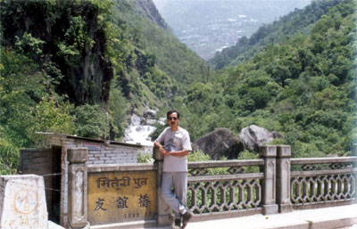 Maitri Pool or Friendship Bridge takes you from Nepal to Tibet. After crossing no man s land you reach the border town Zhangmu that you see in the background. After crossing into Tibet we got into Land Rovers provided by the department of tourism, Tibet. While the guide is Tibetan, the driver is always Chinese.