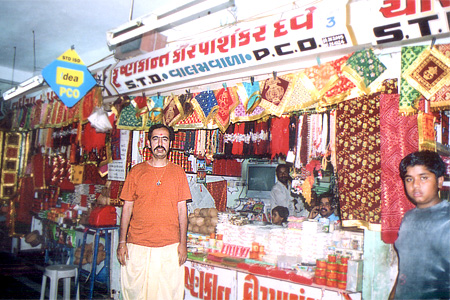 Me in a Dhoti standing outside one of the shops. Ambaji is one of the 64 Shakti Piths. The Shakti Piths were established at those places where the pieces of Sati`s body fell. It came about this way. Shiv`s father-in-law Daksha Prajapati felt insulted when