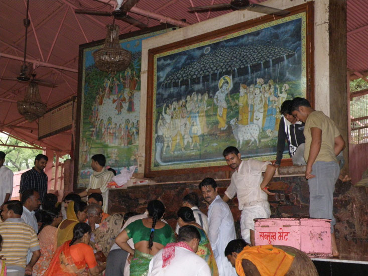 Another view of devotees doing Abhishek. Devotees also offer Jalebi to the Lord and distribute thereafter.