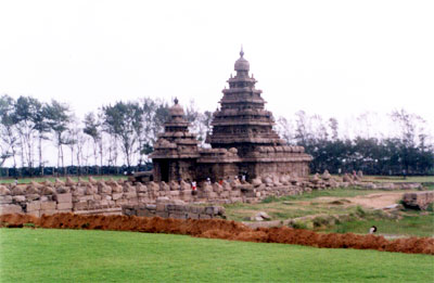 Overview of Shore Temple. It is a structural temple meaning using blocks of stones for constructing temples. Shore temple is a temple complex consisting of two Siva temples and a carving of Anantasayana Vishnu. The temple facing east is entered by a small gopura (smaller one). On plan, it consists of a small sanctum & a front mandapa & is a two-tired vimana. The sanctum is housing a linga. The temple facing west is also dedicated to Lord Shiva. The temple is large in plan comprising sanctum, mahamandapa, front mandapa, balipitha and dvajastamba.  The carving on Lord Vishnu on a boulder in Anantasayana form is lying in between these two temples. It belongs to the period of Narasimhavarman I and thus earlier than the Siva temples.