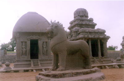 On your right is the Arjuna Ratha. It is a two storied vimana with octagonal sikhara. The wall contains panels of Indra, Siva with Nandi, Vishnu on Garuda etc. To our left is the Draupadi Ratha, the vimana is single tiered and shows square sikhara. On the back wall of the cell is found the depiction of goddess Durga. The shrine is guarded by female door-keepers. The lion that you see in front is the vahana of the goddess Durga