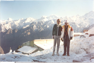 With a friend from Calcutta, note snow clad mountains