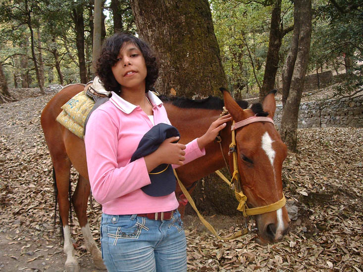 Devyani pats her pony after a 2-hour ride through the Kumaon forests