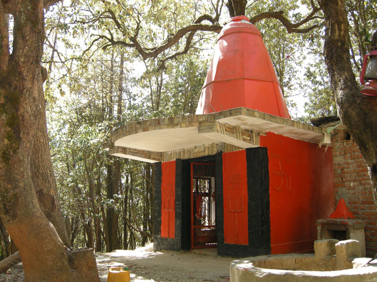 A quaint Shiv-Shakti temple hidden amongst the forest foliage on way to Nainital from Ramgarh