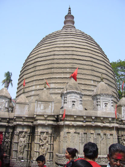 You see the temple. In the shrine, Kamakhya Devi, in the form of genital organ (yoni), presides as a big crevice in the bedrock. The Goddess is covered naturally by a rivulet of water gushing upward from an underground spring. The crevice is usually covered with sari, flowers and vermilion powder (Sindoor).