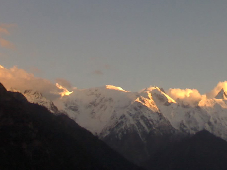Another day, and sunrise under the setting crescent moon over Kinnaur Kailas in Kalpa.
