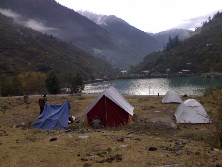 Campsite in the little village of Kafnu, by the beautiful lake over the Bhaba Dam. The lights over the lake lend a magical glow to the dreamy landscape in the chill of the night, viewed from the tent before falling asleep. In the middle of the night, the accompanying pack of mountain strays howled in unison to wake up the intrepid porters, to perhaps drive away a prowling leopard. The Pin Valley trek to Spiti begins at this point.