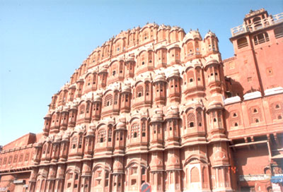 Hawa Mahal is Jaipur's best known monument. Constructed in 1799, the Hawa Mahal or Palace of Winds is a five storey building overlooking the main street of the bustling old city, is a stunning example of Rajput artistry with its pink, delicately honeycombed sandstone windows. It was originally built to enable ladies of the royal household to watch every day life & processions of the city.  When I went inside the Hawa Mahal and stood there I found the place very breezy as compared to its surroundings. There is something about the design & architecture of the place, which makes it very breezy, lovely place to sit.