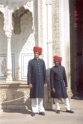 Two palace attendants. Wearing a Pagdi or headgear is common in Rajasthan like in other parts of North India. However, residents of different areas tie the padgi in different ways.