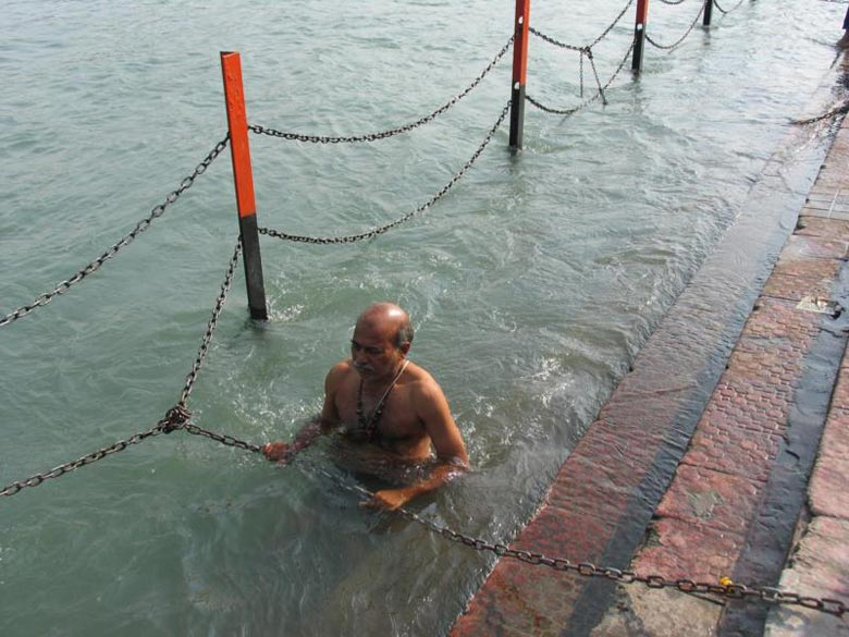 A devotee taking a dip in the Holy Ganga. Bathing in the holy river during the Kumbh Mela is said to liberate the soul from the painful cycles of life and death.