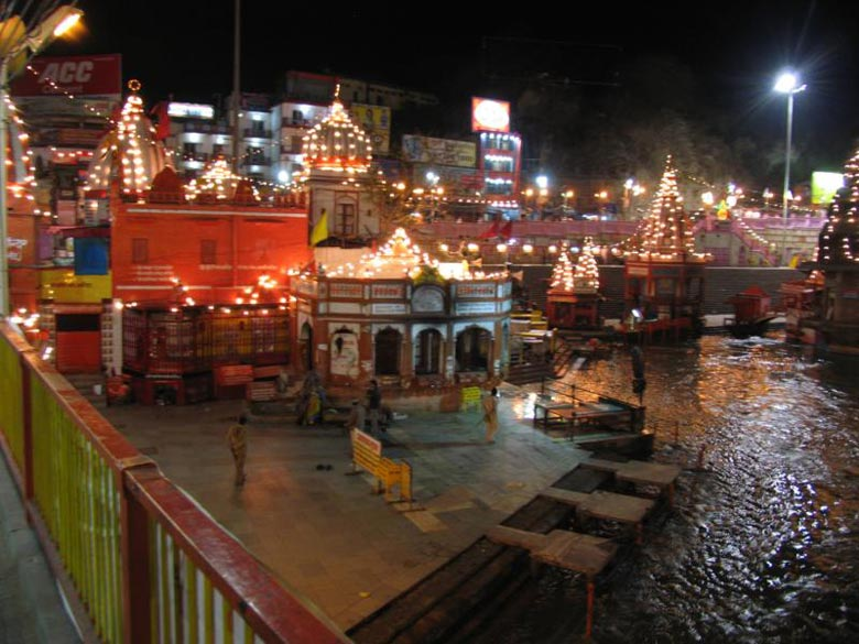 A fully lit up Gangamata Mandir 11.2.2010. The Kumbh attracts visitors from faraway lands like the UK, US, Switzerland, Germany, Italy, France, Russia, Lithuania, Latvia, Japan, Korea, Brazil and Argentina not to forget India. But did not see too many modern young Indians.