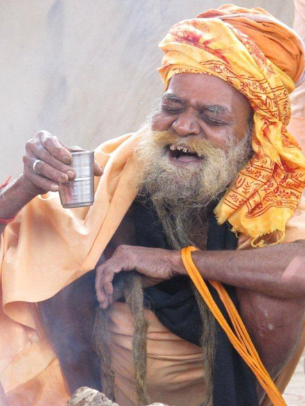 A laughing Sadhu enjoying his tea.