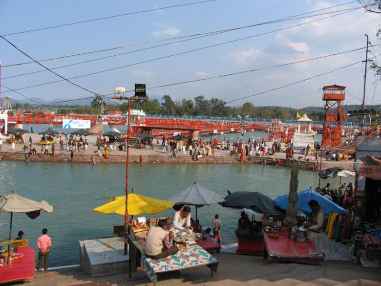 Another view of the Ganga canal. You can see Pandits sitting below the umbrellas.