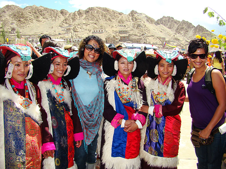 Posing with women with the stunning PERAK on their heads