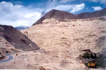 Place is known as Moonland, Lamayuru. The village is on the Leh Srinagar highway. Its monastery here is one of the landmarks of Ladakh.