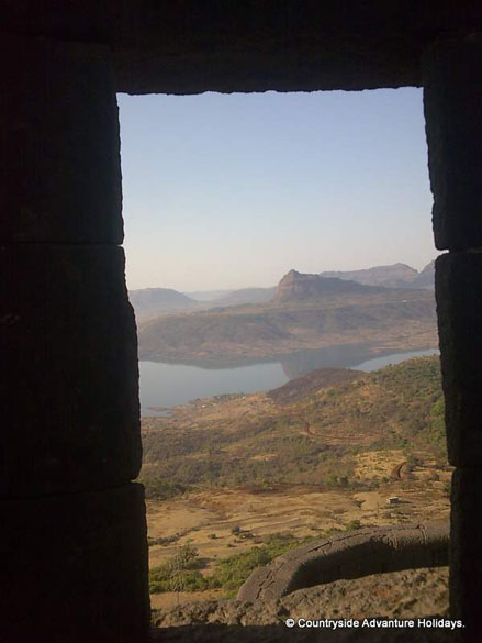 A view of Pauna Dam from the fort and you see the reflection of the Tung Fort in water.