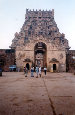 This is the entrance to the Brihadesvara Temple, Thanjavur (Daksina Meru). It is the most amazing temple that I have ever seen. It is the greatest creation of Raja Chola I (985-1012) & was consecrated for worship in 1010 a.d. What you see bang in front is a welcome arch. Although it may appear that the gopuram behind is part of the arch it is not as the next picture shows