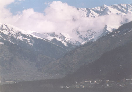 Mother Nature, Clouds hiding snow clad mountains. Also visit Vashisht, a lovely little village about 4 kms by road up the hillside from the Mall. With numerous old stone houses and some ancient temples it deserves a look. You can bathe in the hot springs