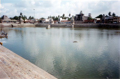 The Temple Tank known as Mahamagam Tank is 12 Acres in area and has  well-laid out steps on all the four sides.  In the centre of the tank, there  are 9 wells in which the Holy Rivers converge.  On the four banks of the  Tank, there are 16 Sannathis for 16 Mahalinga Swamis, known as Shodasa  Lingas.  (These 16 temples are said to have been built by one Sri Govinda  Deekshitar, who was the Chief Minister for the King, Achuthappa Naicker  around 1545 A.D.  The King gave him gold by his weight, with which he has  built these temples)