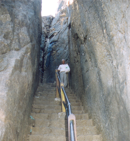 This picture shows steps with rocks on both sides.