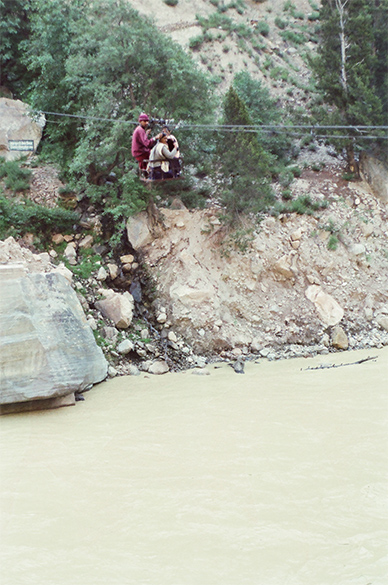 Thanks to Chinese sponsored floods, bridges in Kinnar got washed away forcing locals to cross the Sutlej river (flows in from China, source Mansrovar) like this.