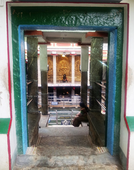 The narrow wooden doorway leads down to the central pond of the complex and is perfectly aligned with the Shivling and Nandi Bull statue across it.