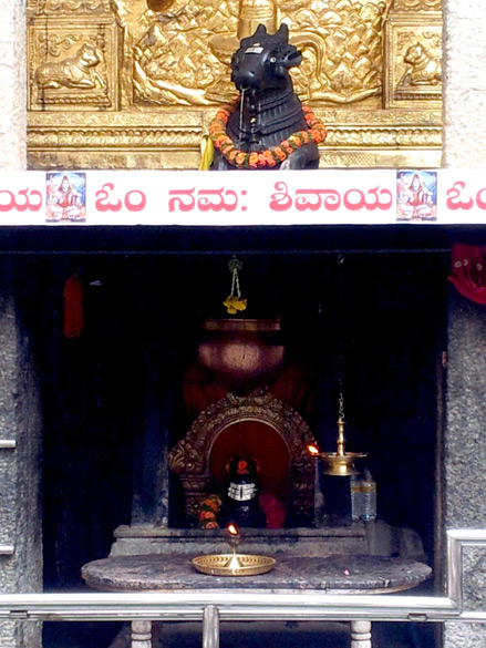 "The water from the Nandi Bull's mouth falls into the brass container – few of the new additions to the temple – and onto the Shivling. The temple deity – Lord Shiva – here is known as ""Abhisheka Priya"" which means the God loves being anointed."