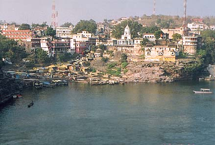 Devotees who want to come by boat take one from this ghat that you see in the center of this picture.