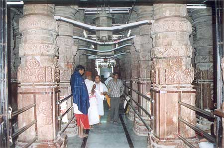 This passage is as you enter the temple. Columns look ancient. The flooring has been renovated and now has granite.