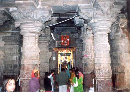 As we walked further through the passage we see the entrance to the main sanctum. Note the images on the columns are all disfigured (saw similar figures in Ellora temples too).