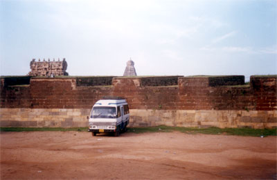 This picture shows fort wall two behind the vehicle. There is another around the main temple. You can see the gopuram to your left and main temple in the background.