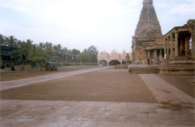 This is the left side of the courtyard. Right small structure is where the Nandi resides behind which is the main temple. The Pandal that you see were birthday celebrations of Raja Chola I the man who made the temple.
