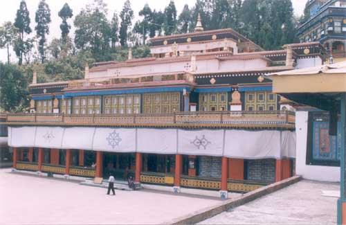 A view of the main shrine with its spectacular wood carved facades, which stands at the end of the courtyard in the monastery.