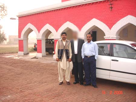 What you see is the State guesthouse at Nankana Sahib. On my right is our gunman Abdul Rauf. To my life is Murtaza. Nankana Sahib was the birthplace of the first Guru Guru Nanak Dev in 1469. The name of the place that time was Raj Bhoj ki Talwandi.