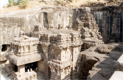 A closer look from south side shows entrance to main temple (extreme left), main temple supported by 16 pillars (see four lions on its top) and Vimana at the end. The main temple + Vimana is raised over a loft plinth nearly 25 feet high that forms the ground storey.